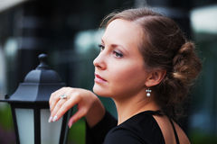 Beautiful woman at lamppost Royalty Free Stock Photo