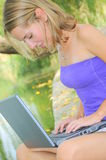Beautiful woman with laptop Royalty Free Stock Image