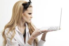 Beautiful woman with laptop stock photos