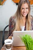 Beautiful Woman With Laptop At Cafe Stock Photo