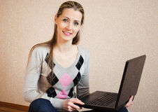 The beautiful  woman with the laptop Royalty Free Stock Image
