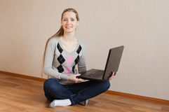The beautiful  woman with the laptop Royalty Free Stock Photography