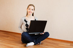 The beautiful  woman with the laptop Stock Photography