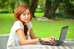 Beautiful woman with laptop Royalty Free Stock Photography