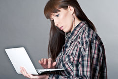 Beautiful woman with a laptop Stock Images