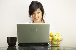 Beautiful woman with laptop over white Stock Image