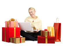 Beautiful woman with laptop and presents Stock Image