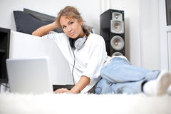 Beautiful woman with laptop sitting on the floor Royalty Free Stock Photography