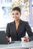 Beautiful woman with laptop smiling Royalty Free Stock Image