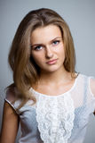 Beautiful woman in lase shirt. Beautiful woman with long hair in lase shirt. Studio shoot Royalty Free Stock Photography