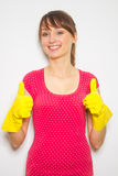 Beautiful woman with latex gloves  on white. Royalty Free Stock Photo