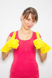 Beautiful woman with latex gloves  on white. Stock Image