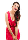 Beautiful woman laughing. A beautiful young woman in a red dress laughing and looking at camera. Isolated on white stock photos