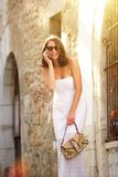 Beautiful woman laughing with mobile phone outside Stock Photos