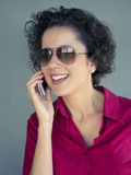 Beautiful woman laughing and talking on the cell phone Stock Image