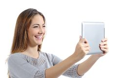 Beautiful woman laughing watching a digital tablet. Isolated on a white background stock photos