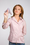 Beautiful woman launching paper plane stock photos