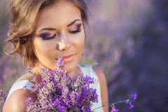 Beautiful woman and a lavender field Royalty Free Stock Image