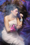 Beautiful woman lay on organza. Sleeping beauty. Royalty Free Stock Photo
