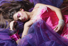 Beautiful woman lay on organza. Sleeping beauty. Royalty Free Stock Image