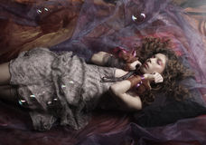 Beautiful woman lay on organza. Sleeping beauty. Royalty Free Stock Photos
