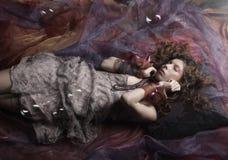 Beautiful woman lay on organza. Sleeping beauty. Royalty Free Stock Photos