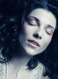 Beautiful woman lay on organza. Sleeping beauty. Stock Photography