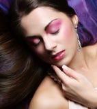 Beautiful woman lay on organza. Sleeping beauty. Stock Photo