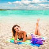 Beautiful woman laying on beach Royalty Free Stock Photo