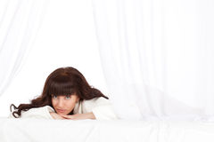 Beautiful woman laying on bed Stock Images