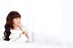 Beautiful woman laying on bed Royalty Free Stock Photography
