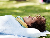 Beautiful woman laying down in summer park Stock Photos