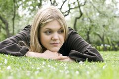 Beautiful woman laying on the grass Stock Photos