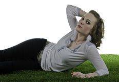Beautiful woman laying on grass Stock Images