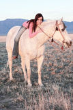 Beautiful Woman Laying on Horse royalty free stock image