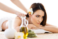 Beautiful woman laying on a mat having a smell of aroma in spa salon Stock Photos