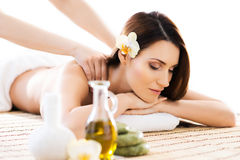 Beautiful woman laying on a mat having a smell of aroma in spa salon Royalty Free Stock Image