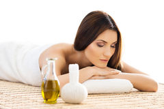 Beautiful woman laying on a mat having a smell of aroma in spa salon Royalty Free Stock Images