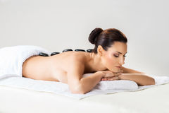 Beautiful woman laying on a mat having a smell of aroma in spa salon Royalty Free Stock Photography