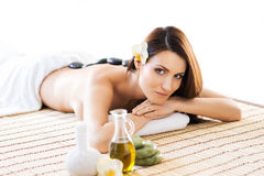 Beautiful woman laying on a mat having a smell of aroma in spa salon Stock Image