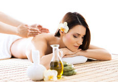 Beautiful woman laying on a mat having a smell of aroma in spa salon Royalty Free Stock Photos