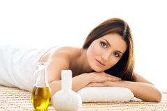 Beautiful woman laying on a mat on a massage procedure Royalty Free Stock Photos