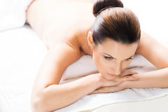 Beautiful woman laying on a mat on a massage procedure Royalty Free Stock Photography
