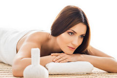 Beautiful woman laying on a mat on a massage procedure Royalty Free Stock Image