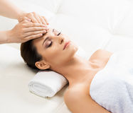 Beautiful woman laying on a mat in a massage salon Royalty Free Stock Photos