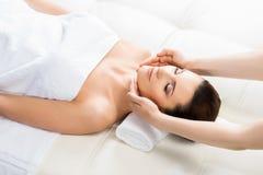 Beautiful woman laying on a mat in massage salon Stock Photos