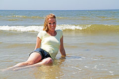 Beautiful woman laying in the ocean Stock Photo
