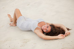 Beautiful woman laying on the sand Royalty Free Stock Photo