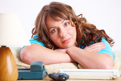 Beautiful woman laying on sofa Stock Image