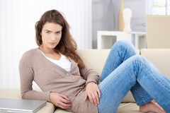 Beautiful woman laying on sofa Royalty Free Stock Images